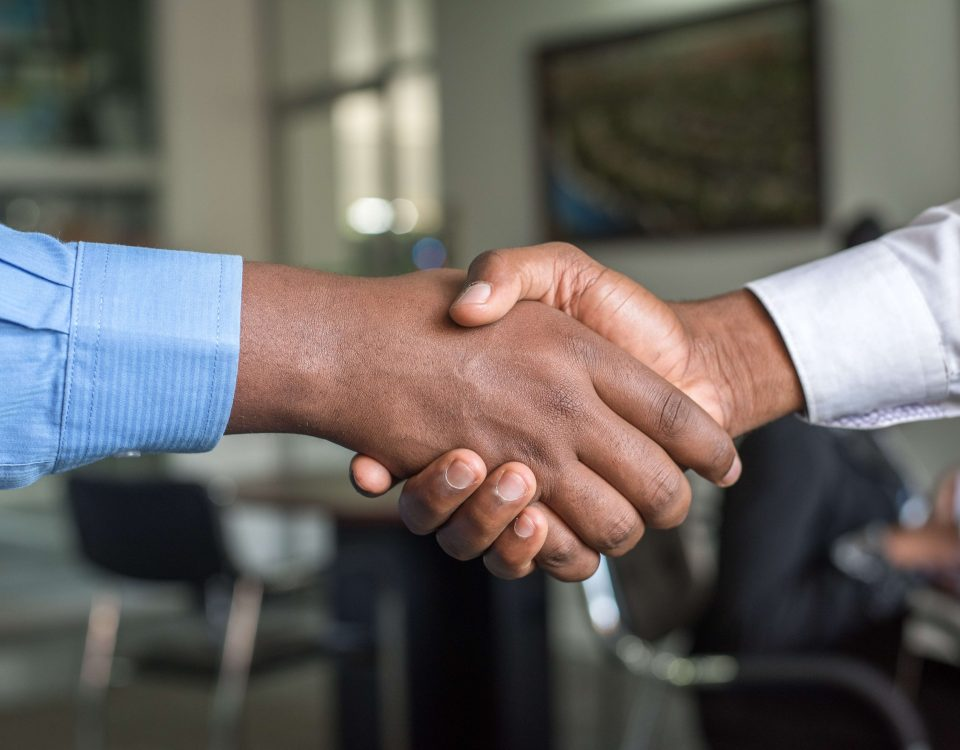 2 men shaking hands and getting their career in the supply chain industry started